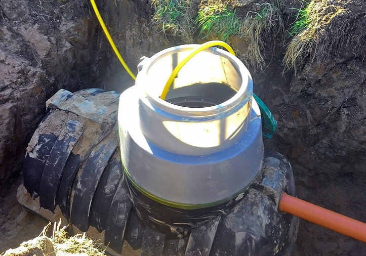 Plumbing drain pipe is being connected to septic tank for waste treatment